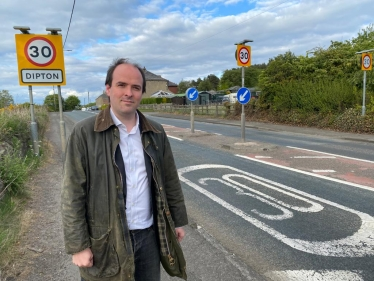 Richard Holden campaigning against speeding in Dipton